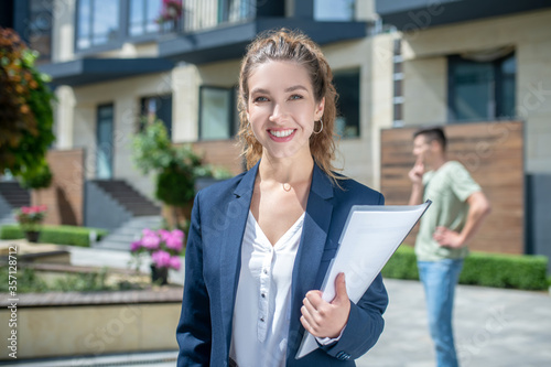 Cute businesswoman in an official outfit smiling nicely Wallpaper Mural