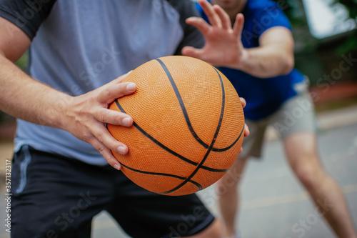 Obraz na płótnie Close up of hands holding ball