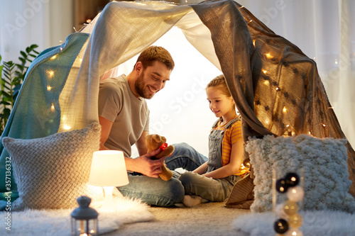 Obraz na plátně family, hygge and people concept - happy father with teddy bear toy and little d