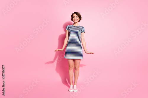 Fototapeta Full length photo of pretty nice lady skinny shapes good cheerful flirty mood wear casual white blue striped mini summer dress isolated pastel pink color background obraz