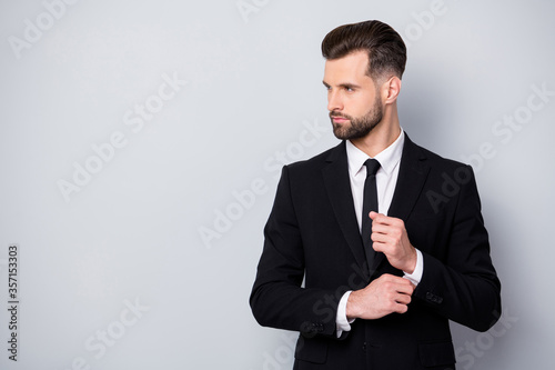 Photo Profile side photo of charismatic serious worker man adjust cufflinks look copys