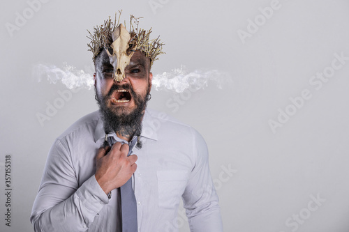 фотография Concept of stress at work with smoke from his ears