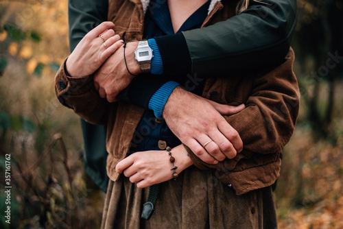 Fotografie, Obraz hands of a guy and a girl intertwined in a hug