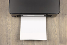 Top View Of A Printer And A Blank A4 Printed Piece Of Paper
