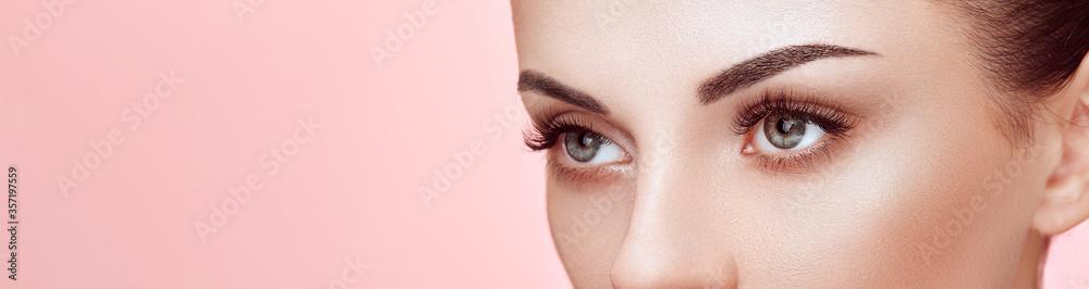 Fototapeta Beautiful Woman with Extreme Long False Eyelashes. Eyelash Extensions. Makeup, Cosmetics. Beauty, Skincare
