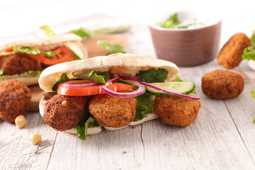 falafel with fresh vegetable in pita bread
