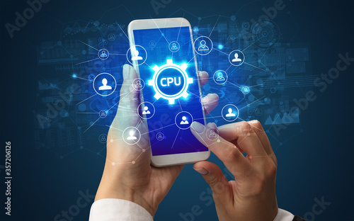 Female hand holding smartphone with CPU abbreviation, modern technology concept Canvas Print