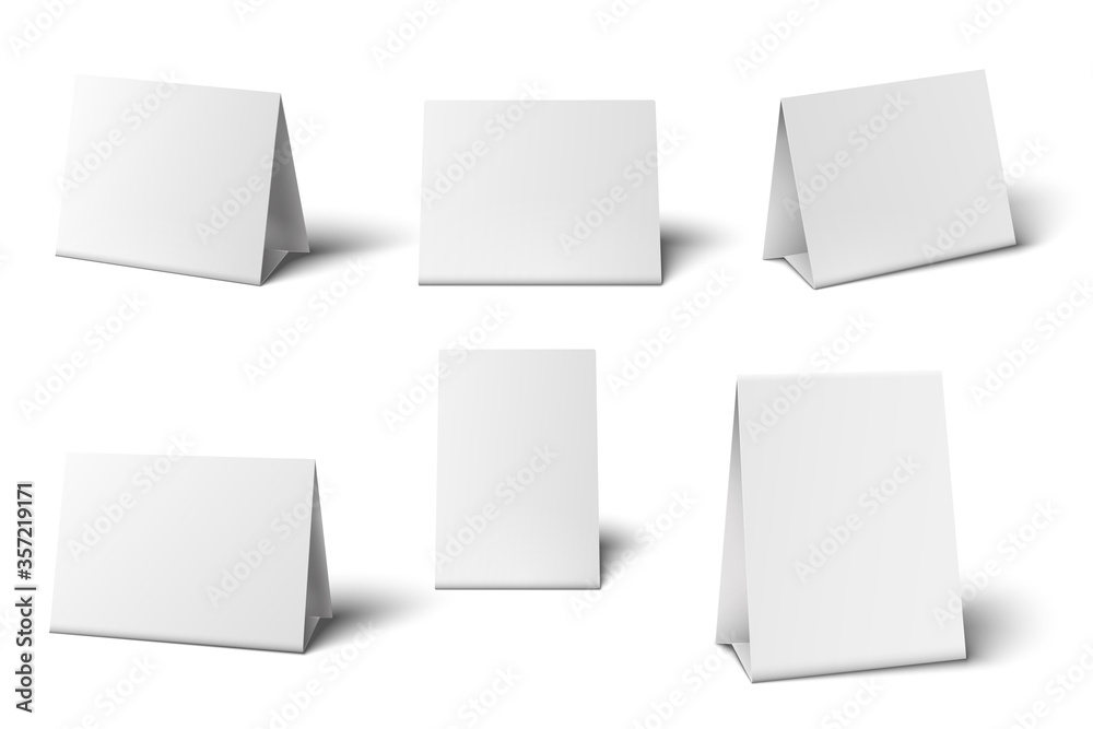 Fototapeta White table card mockup. Desk calendar. Standing blank paper banners for greeting cards restaurant menu 3d isolated template set. Empty realistic table holder object vector illustration.