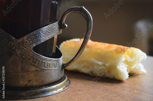 Cuadros en Lienzo A glass of tea and bread. The concept of poverty