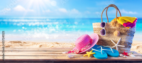 Fotografie, Obraz Beach Bag On Seashore With Accessories - Summer And Sea