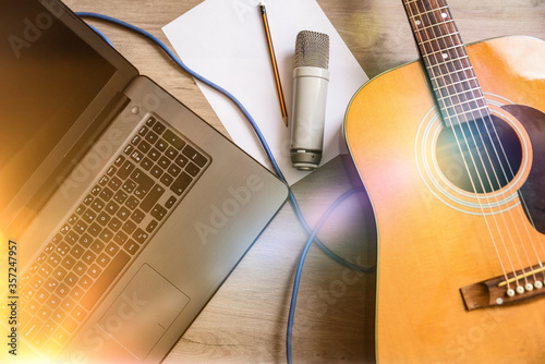 Vászonkép Home recording equipment for music laptop guitar and microphone