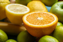 Close Up View Of Orange And Lemon Halves On Fruits
