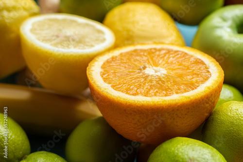 close up view of orange and lemon halves on fruits Fototapeta
