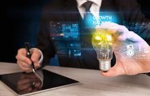 Businessman Holding Lightbulb ...