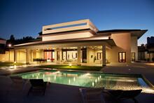 Luxury House And Swimming Pool Illuminated At Night