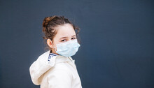 Girl With Surgical Mask In Fro...