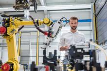 Confident Male Robotics Expert...