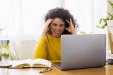 Smiling Woman Using Laptop At ...