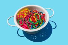Studio Shot Of Colorful Pasta In Colander