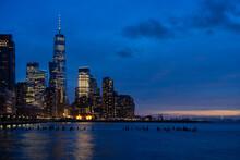 USA, New York, New York City, Hudson River At Night With Illuminated Manhattan Skyline In Background