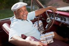 Smiling Older Man Driving Conv...