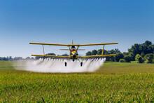 Yellow Crop Duster Spraying Pe...