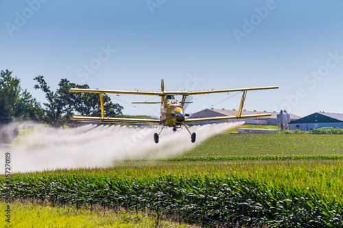 Yellow Crop Duster Spraying Pestisides On Crops Canvas Print
