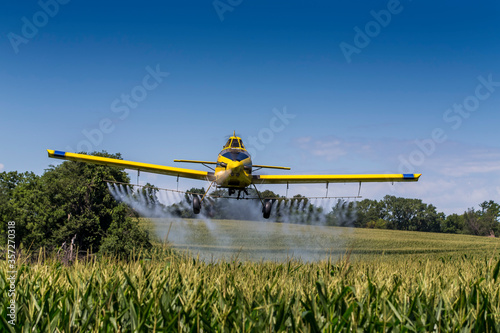 Fotografie, Obraz Yellow Crop Duster Spraying Pestisides On Crops