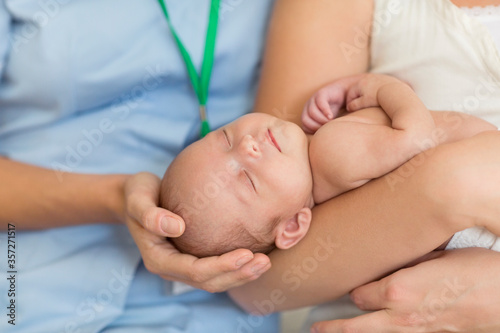 Slika na platnu Nurse and mother cradling newborn baby