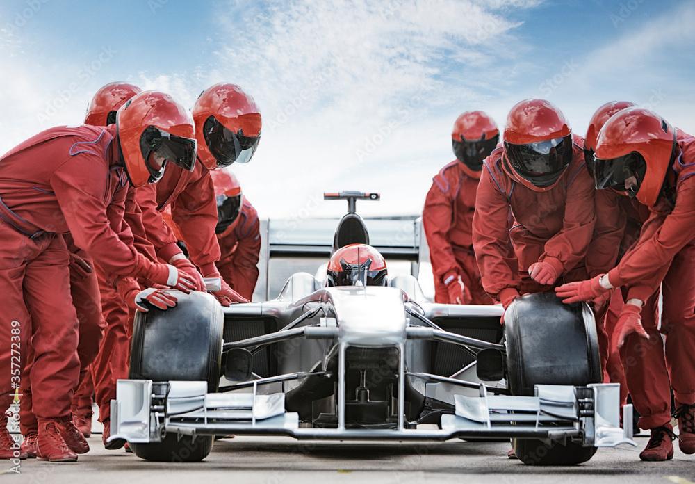 Fototapeta Racing team working at pit stop