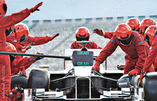 Racing team working at pit stop Canvas Print