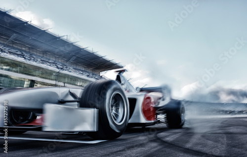 Race car driving on track Fototapete