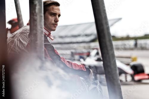 Papel de parede Racer standing on sidelines on track