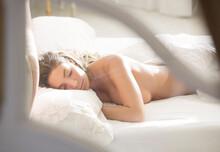 Nude Woman Sleeping In Bed