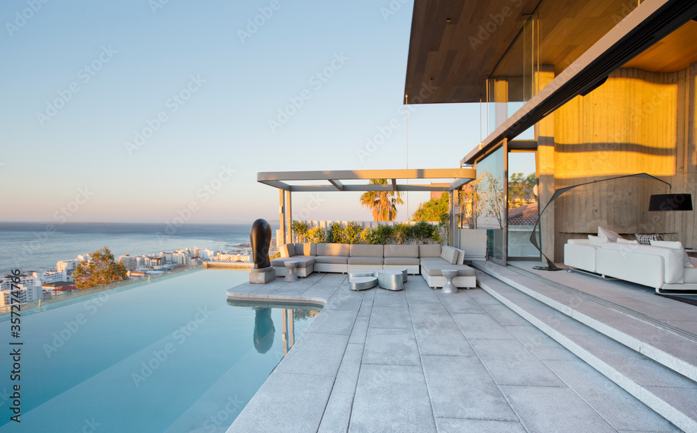 Fototapeta Infinity pool and patio of modern house
