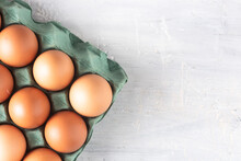 Box Of Red Eggs On A Rustic Wh...