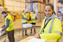 Worker Smiling In Warehouse