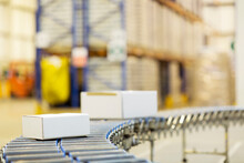 Packages On Conveyor Belt In W...