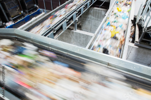 Fotografie, Obraz Blurred view of conveyor belts in recycling center