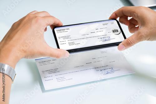 Fototapeta Scanning Remote Deposit Check Document Using Phone obraz