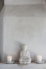 Buddha Figurine And Candles On...