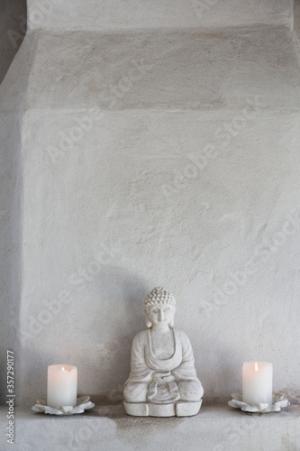 Buddha figurine and candles on ledge Wallpaper Mural