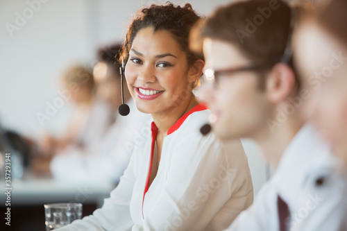 Businesswoman wearing headset in office Canvas Print