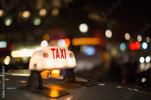Fototapeta Close up of illuminated Parisian taxi light, Paris, France