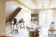 Sofas And Staircase In Modern Living Room