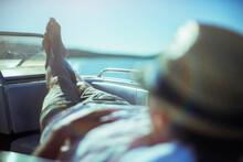 Man Relaxing On Boat Near Beach