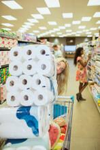 Woman Pushing Full Shopping Ca...