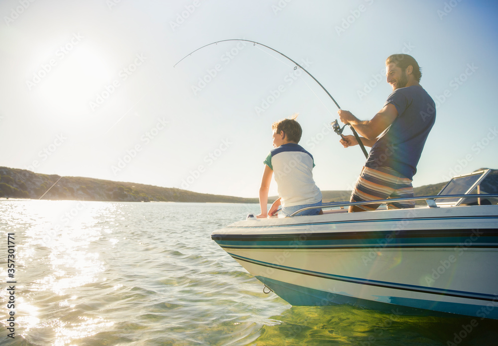 Fototapeta Father and son fishing on boat