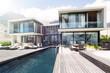 Leinwandbild Motiv Modern house with large patio and swimming pool
