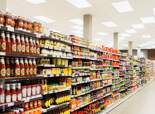 Stocked shelves in grocery store aisle Canvas Print